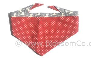 dark red dog bandana with large white polka dot design