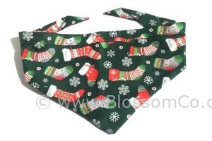 Christmas theme dog bandana. Green with christmas stockings and snowflakes