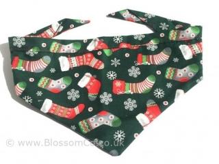 Christmas theme dog bandana. Green with christmas stockings and snowflakes