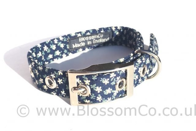 handmade dog collar with delicate floral design on dark blue background
