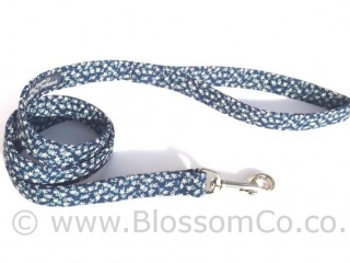 handmade dog collar with delicate floral design on navy blue background