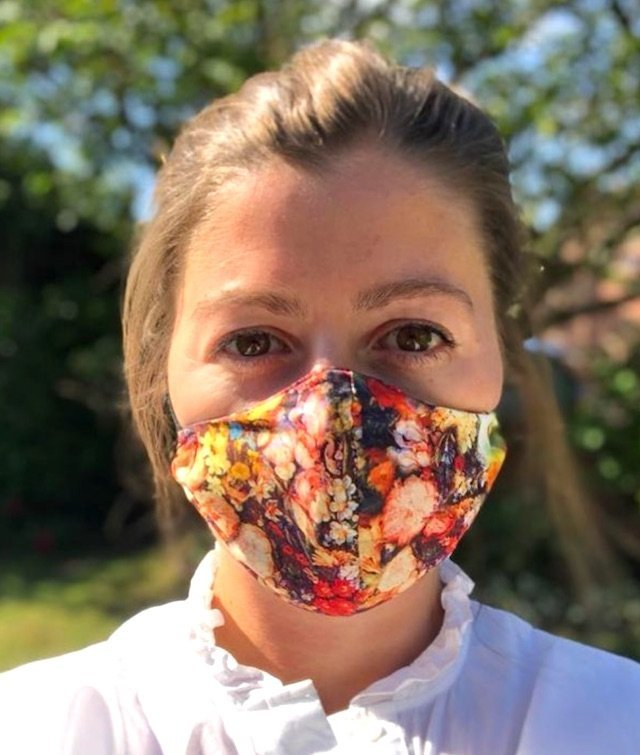 reusable face covering in pretty floral fabric